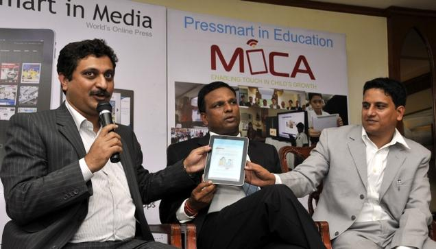 Raghavan Madabhushi, CEO, PressMart, launching the Mobile Learning Classroom Application (MOCA) in Hyderabad on Monday with Vikram Simha Torpunuri, Chairman and Kiran Booneti, COO